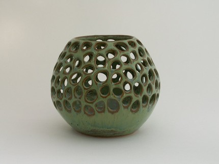 Green-blue speckled candle holder with raindrop cut-outs by askpottery