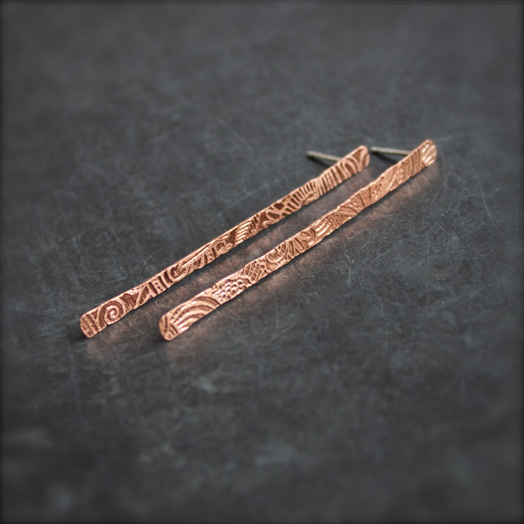 etched copper stick earrings